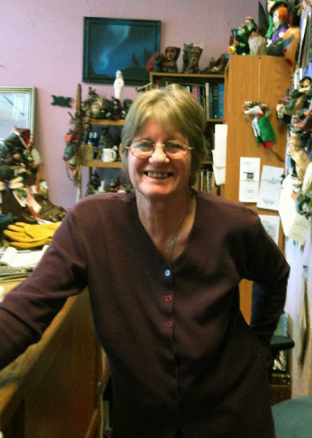 Georgia smiling insider her store Raven Feathers.